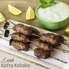 Lamb Kofta Kebabs text. Serve with yellow rice or salad of cucumber, tomatoes, red onions.