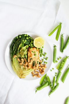 Grilled tofu and lettuce salad with peas and roasted cashews