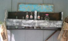 Pallet shelf/bottle holder with bottles from the Stern Wheel Regatta (for those of u who know what that is) that date from the 1970's, how cool is that!!