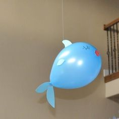 Make fish balloons for the decor. It was very easy to cut the fins & lips from card stock and adhere them with clear tape. The eyes were drawn on with a permanent black marker.