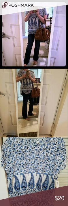 Old Navy Blue and White Paisley print blouse Brand new, never been worn, comfortable and really really cute summer top. I paired it with another amazing posh purchase. Thank you @persistent for my beautiful Cole Haan purse xoxo Old Navy Tops Tunics