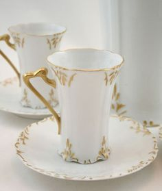 Double your traffic. Limoges France Chocolate or Tea Set White porcelain with hand-painted gilt accents and gilded handles. Very translucent porcelain. Auction includes lidded pot and four sets of cu