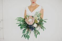 bridal bouquet with large King Protea flower