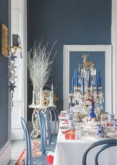 A festive dining room with walls in Stiffkey Blue Estate Emulsion, trim in Wevet Estate Eggshell and chairs in Stiffkey Blue Estate Eggshell. Dark Walls, Blue Walls, Room Colors, Wall Colors, Paint Colours, Stiffkey Blue, Dining Room Paint, Ball Chair, Christmas Interiors