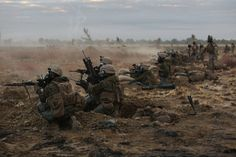 Marines with Company C, 1st Battalion, 1st Marine Regiment, fire down range during a CS gas attack during a live fire range August 18, 2016, at Bradshaw Field Training Area, Northern Territory, Australia. The range was the final training evolution of Exercise Koolendong 16, a trilateral exercise between the U.S. Marine Corps, Australian Defence Force and French Armed Forces New Caledonia. Marines held a defensive position while engaging targets and working through the CS gas, which simulated…