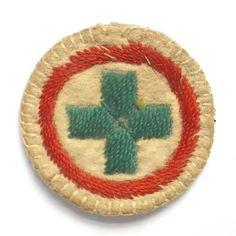 http://www.sallysbadges.com/viewphoto.php?shoph=52752 1916-1919 white felt senior (red band)  badge.  Blue for guide section.  Child nurse - it has a green cross