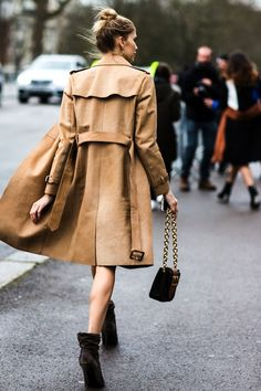We've said it once and we'll say it again. The trench coat is a non-negotiable staple item that every girl must have in her closet. Here's Elena Perminova looking effortlessly sexy in hers with a messy top knot, chain strap bag and slouchy heeled ankle boots.