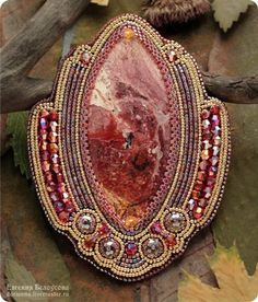 "Brooch ""Flower of Passion"" -- The stone - a large and very beautiful Jasper. Gold - Fifteen Toho with resistant coating (PF). Also added bicones Swarovski and Czech glass beads."
