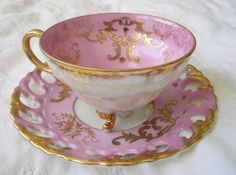 pink and golden tea cup and saucer