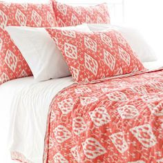 A light quilt in a coral color is great for that beach house guest bedroom. | $275