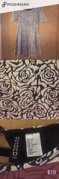 H&M dress. Worn once. Super comfortable. H&M dress. Worn once. Super comfortable. Rose type detailing. Great length H&M Dresses