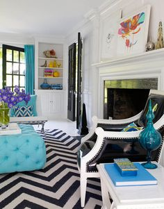 Love the black and white chevron rug with the aqua pops.