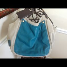 Teal and natural gently used tote sized handbag In like new condition because it was only used once. This bag is perfect for everyday use or when traveling. Has double shoulder straps and pockets that zip code on the inside. No rips tears or stains Bags Totes