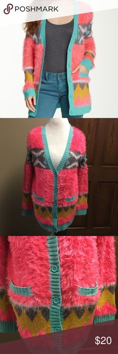Flying tomato fuzzy neon cardigan Oh so soft Flying Tomato cardigan. This sweater is a warm and fuzzy button up cardigan. It is mainly pink with blue, yellow, and grey patterns on it. It's a size large and it is in like new condition!     🌸BUNDLE AND SAVE  🌸NO TRADES 🌸REASONABLE OFFERS CONSIDERED  🌸FEEL FREE TO ASK QUESTIONS 🌸I DO NOT MODEL Flying Tomato Sweaters Cardigans