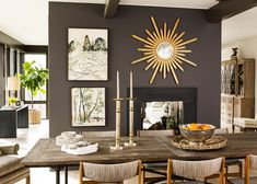 Charcoal painted wall, black FP surround gold accent