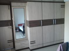 Wardrobe Asian style bedroom by homify Asian Plywood Living Room Partition Design, Pooja Room Door Design, Room Partition Designs, Bedroom Closet Design, Home Room Design, Bedroom Furniture Design, Wardrobe Laminate Design, Wall Wardrobe Design, Wardrobe Interior Design