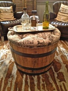 """a nice touch for a """"man cave""""...a small table/ ottoman made from a portion of a wine barrel."""