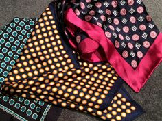 Circle patterned pocket squares by Blaq and Geoffrey Beene.