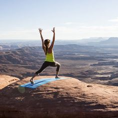 Yoga on red rocks with vista views