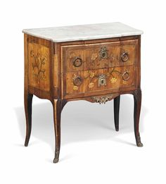 A LOUIS XV ROSEWOOD AND FLORAL MARQUETRY COMMODE -  MID 18TH CENTURY.