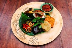 Nasi Ulam which usually enjoyed for breakfast can be also enjoyed as a tasty lunch menu. One of the many dishes you can try in Indonesia