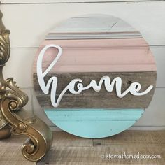Start at Home Decor's New Line of Reclaimed Wood rounds with a home Word cutout.