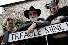 TP and fans dressed in Discworld costumes in the Kingwell Rise housing development in Wincanton, Somerset. Streets in the development have been named after streets in Ankh-Morpork. Wincanton is twinned with Ankh-Morpork, becoming the first town to be twinned with a fictional place.