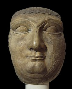 Stone sculpture; face of sphinx that probably belonged to the head of a colossal sphinx put together from different materials such as wood and bronze; regarded as having magical powers.