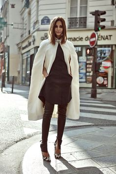 Christine Centenera in white cape coat, black shirt dress, leopard print heels