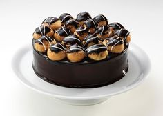 Cake with Profiterole - Special cream with Valrhona chocolate and almond pieces between the layers of chocolate and almond genoise cake