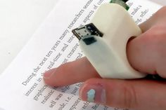 FingerReader, fluid.mit.edu:  A wearable device that assists in reading printed text for both for visually impaired people that require help with accessing printed text, as well as an aid for language translation... #Fluid_Interfaces #FingerReader