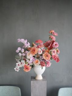 Large Flower arrangement in a white vase