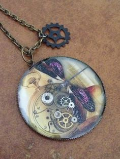 Steampunk dragonfly resin pendant with inlaid gears and charm