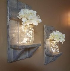 These adorable Sets of Candleholders serve as a Shelf, a Mason Jar Vase, A Candleholder with lights. Add Flowers or change them for each season and have many decorating options. These are Made from Rustic reclaimed wood and are stained Classic Grey. You can order with these popular Firefly lights only, or order with lights and flowers, or Flowers only ( No Lights) Each candle holder will be unique in itself and have its on Unique features. It may have cracks, holes, knots, dark and light…