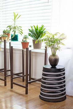 Decorate an old trash bin and repurpose it into a plant stand