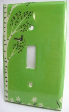This lovely light switch plate features a vintage graphic. This is in the bright green colorway, also available in amber.    Light switch plates are