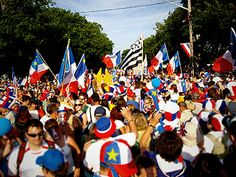Acadians celebrating the Tintamarre and National Acadian Day in Caraquet, New Brunswick