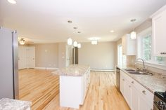 www.CCHFI.com Chase Custom Homes & Finance. Maine New Home Construction. Open concept. Living Room. Kitchen. Gorham, ME