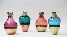 Lovely vases created with glass and wood.