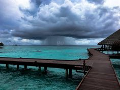 Twenty20 ~ Storm Cloud on Maldives Beach