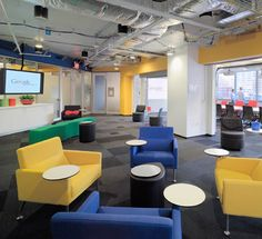 Google office London. Floating discs! An update on the old lecture theatre desks that had fold down writing surfaces.
