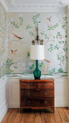Loving the wallpaper and decorative lamp. Theres never enough drawers is one house.