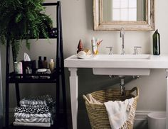 Small bathroom ideas-   Store towels and toiletries neatly on elegant shelves (an especially useful strategy when there's no spare closet). A hamper with handles stowed beneath an open sink goes directly from bathroom to laundry room.
