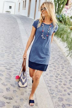 You loved our T-shirt dress so much last season that we've updated the fabric and brought it back (looking better than ever) with new colourblock styles. Made from soft, lightly textured slub cotton, this crew neck dress drapes gently for an easy-going fit. Team with slip-on trainers and a rucksack for shopping trips or dress it up with an oversized blazer.