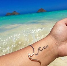 dainty wave tattoo