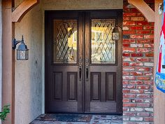 """AFTER: 5 Foot (Double 30"""") size classic style fiberglass doors. Plastpro Model DRG60 Oak grained surface, factory stained Walnut. ODL Canterbury glass with patina caming. Emtek Nashville hardware. Installed in Laguna Niguel, CA home."""
