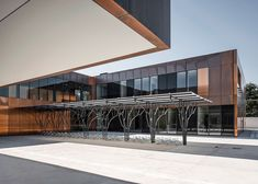LCR Architectes clads French middle school with tarnished copper
