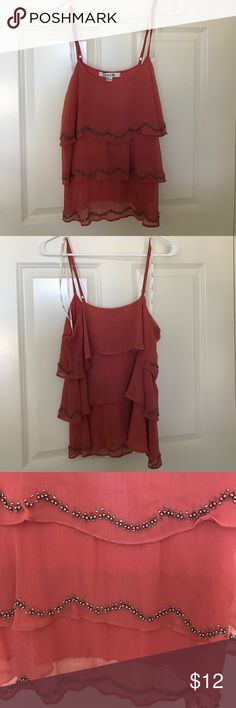 Summer blouse Salmon colored tank with beading detail along the ruffles. Beading is a silver/black chrome color. Beading looks to be in good shape, no noticeable defects. Worn one time. Forever 21 Tops Tank Tops