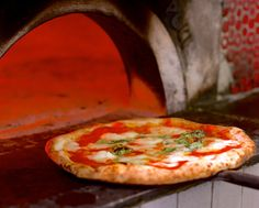 A little history on one of the world's most popular foods. You know what goes good with pizza? Wine stored or cooled by Vinotemp