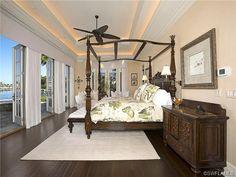 Coastal Bermuda bedroom - dark wood floors - waterfront.  Moorings in Naples, FL